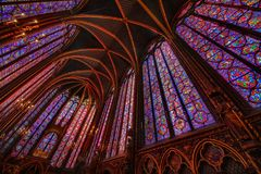 The Sainte Chapelle in la Cite of Paris. Spectacular stained glass windows and mosaics inside of the Sainte Chapelle of Paris Stock Photo