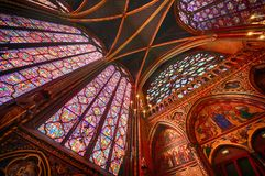 The Sainte Chapelle in la Cite of Paris. Spectacular stained glass windows and mosaics inside of the Sainte Chapelle of Paris Stock Photography