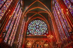 The Sainte Chapelle in la Cite of Paris. Spectacular stained glass windows and mosaics inside of the Sainte Chapelle of Paris Stock Image