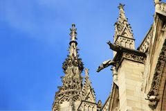 The Sainte-Chapelle is a royal chapel in the Gothic style of Paris. Gargoyles and sculptures in the façade of the Sainte-Chapelle, in the Cite Island in stock photo