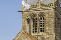 Sainte-Mère-Eglise. Paratrooper hanging from the church steeple in Sainte-Mère-Eglise Royalty Free Stock Images