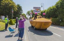 St. Michel Caravan - Tour de France 2015. Sainte Marguerite sur Mer, France - July 09, 2015: St. Michel Madeleines Caravan during the passing of Publicity stock images