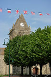 Sainte-Mere-Eglise. Church and flags of the allied liberators. The church played a role on D-Day, June 1944 Stock Images