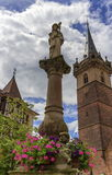Sainte-Odile fountain and Kappelturm in Obernai village, Alsace, Stock Images