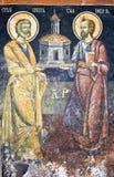 Saints dans une vieille peinture Photos stock