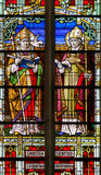 Saints Gregory and Ambrose - Stained Glass. Stained Glass window depicting Saints Gregory and Ambrose, in the Cathedral of Mechelen, Belgium Stock Images
