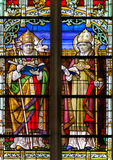 Saints Gregory and Ambrose - Stained Glass. Stained Glass window depicting Saints Gregory and Ambrose, in the Cathedral of Mechelen, Belgium Royalty Free Stock Photos