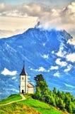 Saints Primus et église de Felician dans le village de Jamnik, Slovénie image libre de droits