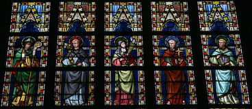 Saints. Stained glass window depicting Roman Catholic saints in the church of Our Lady in Saint Truiden, Belgium Royalty Free Stock Photo