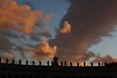 Saints statues on a fiery sky Royalty Free Stock Image
