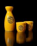 Sake. Set for oriental sake. Black background Stock Image