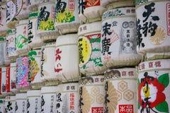 Sake Barrels at Meiji shrine in Tokyo. Sake Barrels full of rice wine with Japanese writing at Meiji-Jingu Shrine, Tokyo, Japan Royalty Free Stock Photos