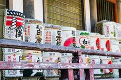 Sake Barrels. Traditional sake barrels stacked outside a shrine in Japan Stock Photos