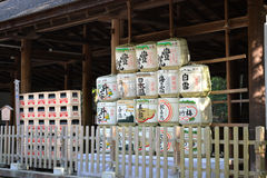 Sake Barrels Under Roof. Sake barrels stacked and displayed under a traditional roofed structure in the Kansai region of Japan Royalty Free Stock Image
