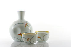Sake Bottle and Cups. Japanese porcelain sake bottle and two cups Royalty Free Stock Photography