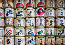 Sake casks. Japanese sake rice wine barrels with decorative writing in a japanese temple Stock Images