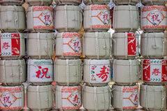 Sake casks lined and stacked at the wall Royalty Free Stock Photo