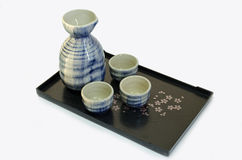 Sake cups and bottle Royalty Free Stock Photos