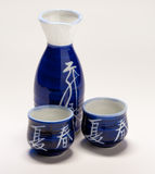 Sake flask and cups. Close-up of sake flask and two cups with blue and white asian design Stock Photos