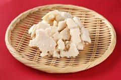 Sake kasu ( japanese rice wine lees). On red background Royalty Free Stock Image
