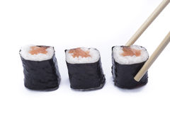 Sake maki with chopsticks Stock Photo