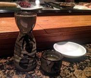 Sake Serving. Image of a tokkuri and guinomi of sake at a sushi restaurant Stock Photos