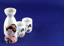 Sake set. On blue background Royalty Free Stock Photos