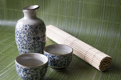 Sake set. On green background Japanese style Stock Photo