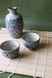 Sake set on bamboo pad. In Japanese style Royalty Free Stock Photography