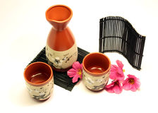 Sake set with flowers Royalty Free Stock Images