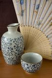 Sake set with wooden fan Royalty Free Stock Photography