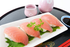 Sake and sushi Stock Photography