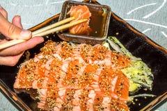 Sake tataki in soy sauce Stock Photos