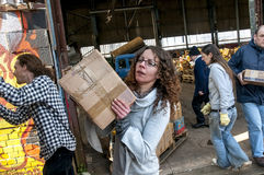 Sakeenah Feghir from BookCycle UK carring a box of books Royalty Free Stock Image