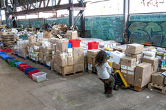 Sakeenah Feghir from BookCycle UK pulling a pallet of books Royalty Free Stock Photo