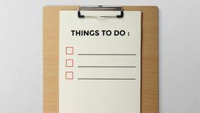 Saker som gör skriftligt på skrivplattan arkivbild
