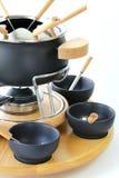 Sakkunniguppsättning av redskap för att laga mat fondue Arkivfoto