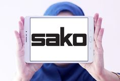 SAKO Finnish firearm company logo. Logo of SAKO company on samsung tablet holded by arab muslim woman. SAKO is a Finnish firearm and ammunition manufacturer stock images
