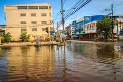 Sakon Nakhon, Thailand - August 4, 2017: Difficulty transportati. On in a heavy flooding situation in urban Sakon Nakhon, Thailand. The heavy flood in Sakon Royalty Free Stock Photo