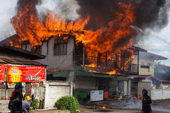 Sakon Nakhon, Thailand on September 13, 2015 at 15:00 o'clock. c. Onflagration damaged nearly the entire house. Fire officials estimated the cause of the short Stock Photography