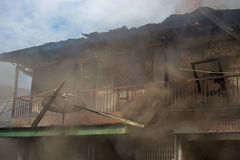 Sakon Nakhon, Thailand on September 13, 2015 at 15:00 o'clock. c. Onflagration damaged nearly the entire house. Fire officials estimated the cause of the short Stock Photos