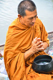 Sakonnakhon THAILAND-July 8:Buddhist monk is the alms. On morning at Yam river floating market on July 8, 2014 in Sakonnakhon Thailand Stock Photography