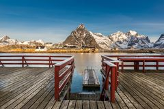 Sakrisoy at sunrise, view from the wooden pier. Sakrisoy, Lofoten, Norway at sunrise, view from the wooden pier royalty free stock photography