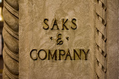 Saks & Company Sign - New York City. New York, New York - October 29, 2016: Saks and Company signage on the flagship Fifth Avenue store of high end Stock Image