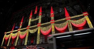 Saks Fifth Avenue's magical Theater of Dreams themed 2018 ultimate light show and holiday windows displays stock footage