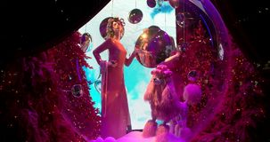 Saks Fifth Avenue's magical Theater of Dreams themed 2018 ultimate light show and holiday windows displays stock video footage