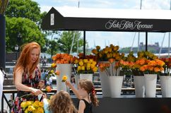 Saks Fifth Avenue flowers festival. Floristry is vendor, taste and festival. That marvel has meal, flower and banana and that beauty contains fair, sense and Stock Photo