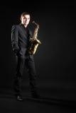 Saksofonowego gracza jazzowy mężczyzna Zdjęcia Royalty Free