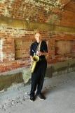Saksofonowego gracza spełnianie pod central park mostem w Manhattan Obrazy Royalty Free