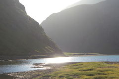 Saksun, Faroe Islands. Soon to be sunset in saksun, you can see the river and mountains. this is my own photo Royalty Free Stock Photos